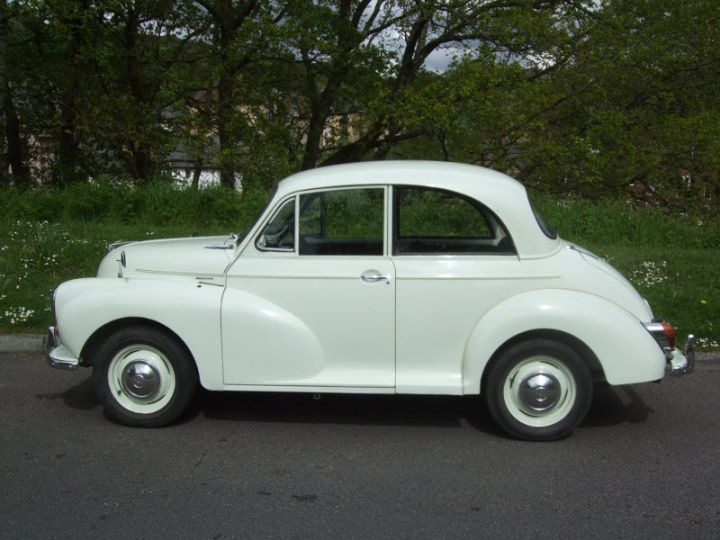 Snowberry White 2-door saloon with black interior trim