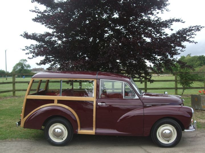 MAROON TRAVELLER WITH CHEROKEE RED INTERIOR TRIM